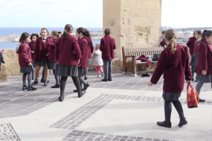valletta-malta-children-girls-from-church-school-play-with-street-birds-pig_bkfmukqsl_thumbnail-full01